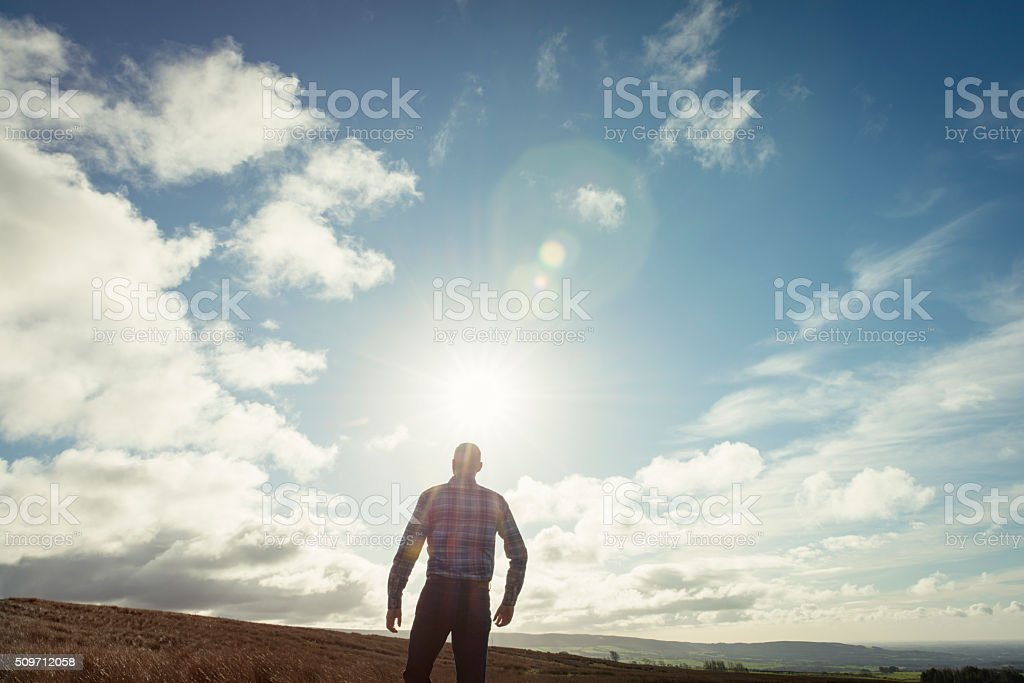 man in nature with Sun Flare stock photo