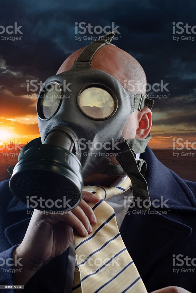 Man in neck tie and gas mask stock photo