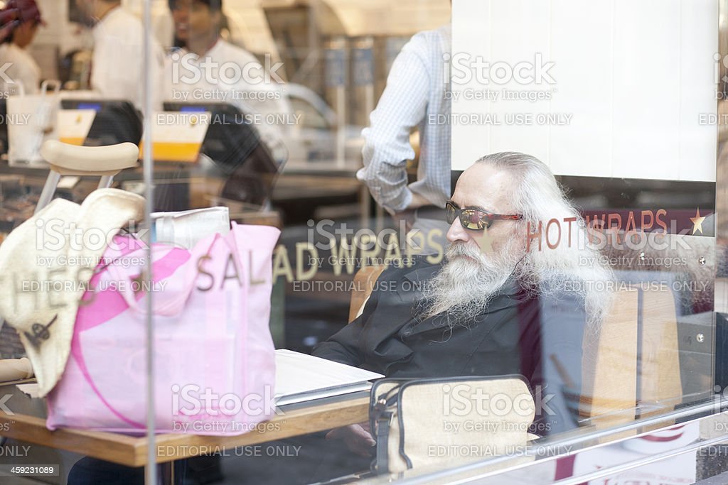 Man in NYC Restaurant stock photo