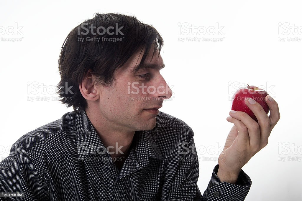 Man in Office eating an apple royalty-free stock photo