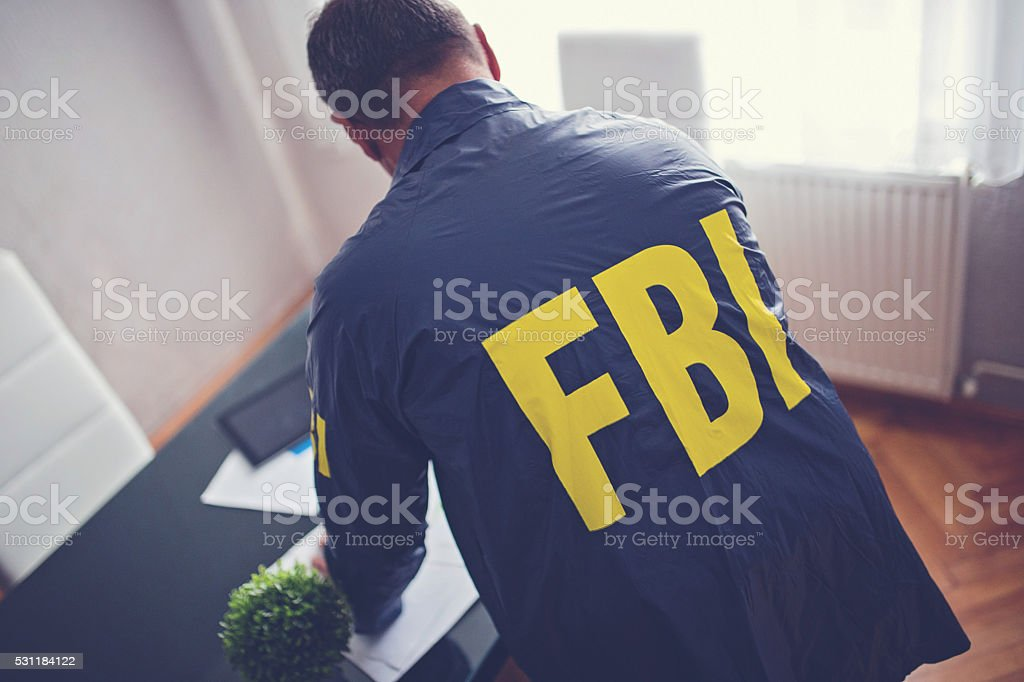 FBI man in office stock photo