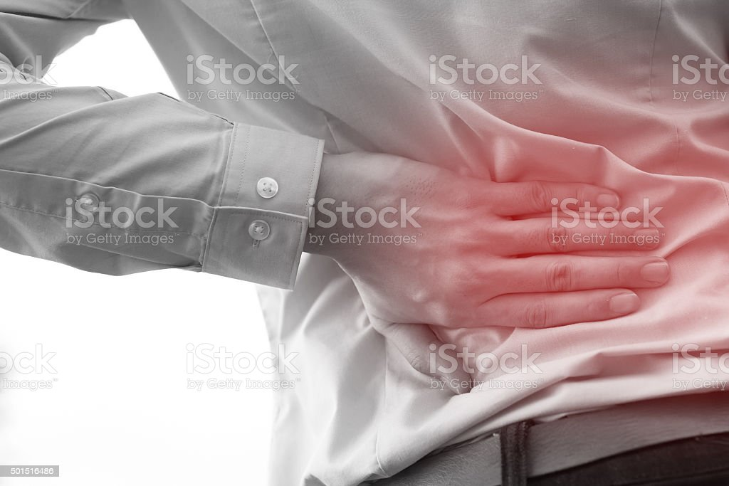 Man in office uniform having back pain / back injury stock photo