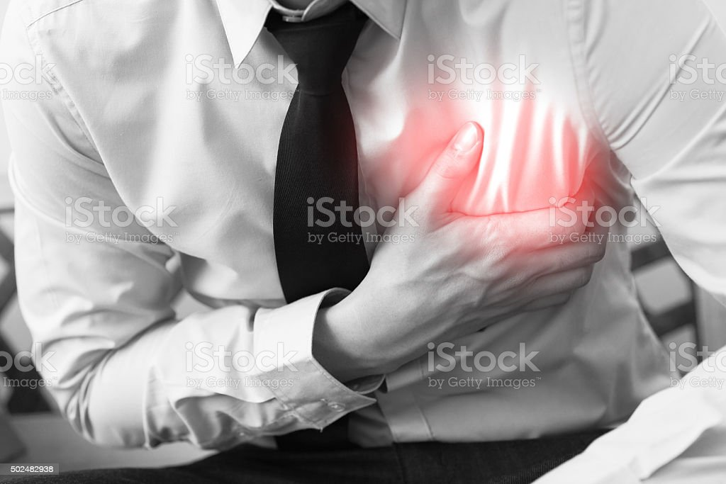 Man in office uniform having heart attack / heart burn stock photo