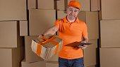Man in orange uniform delivering heavily damaged parcel to customer