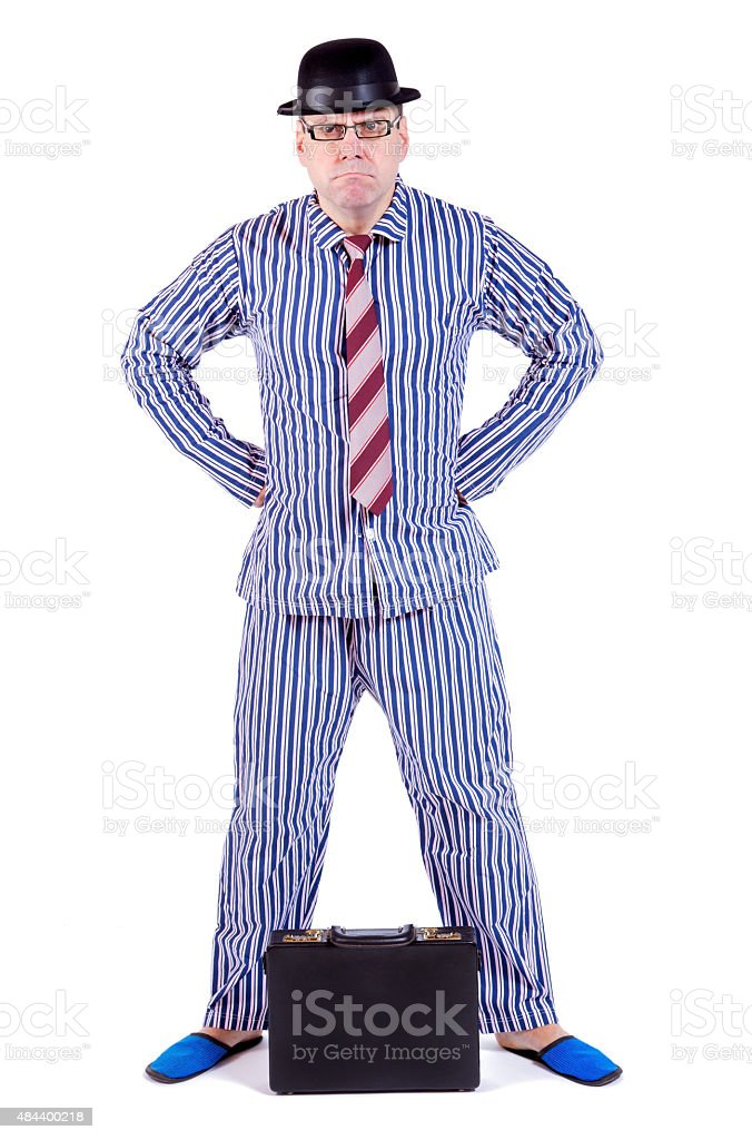 man in pajamas with suitcase stock photo