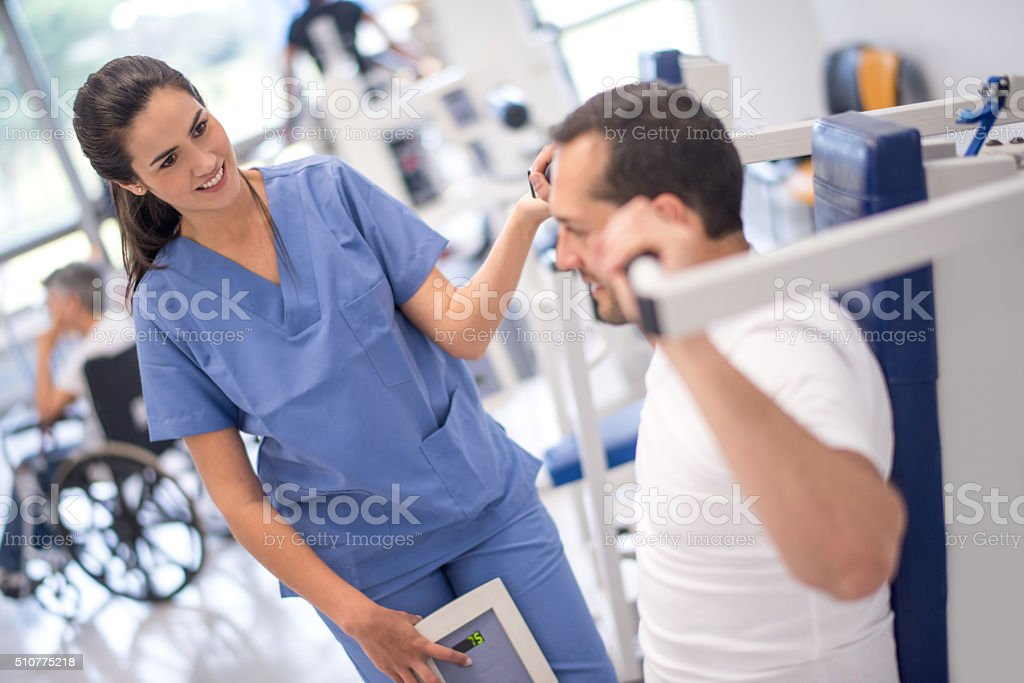Man in physical therapy at the hospital stock photo