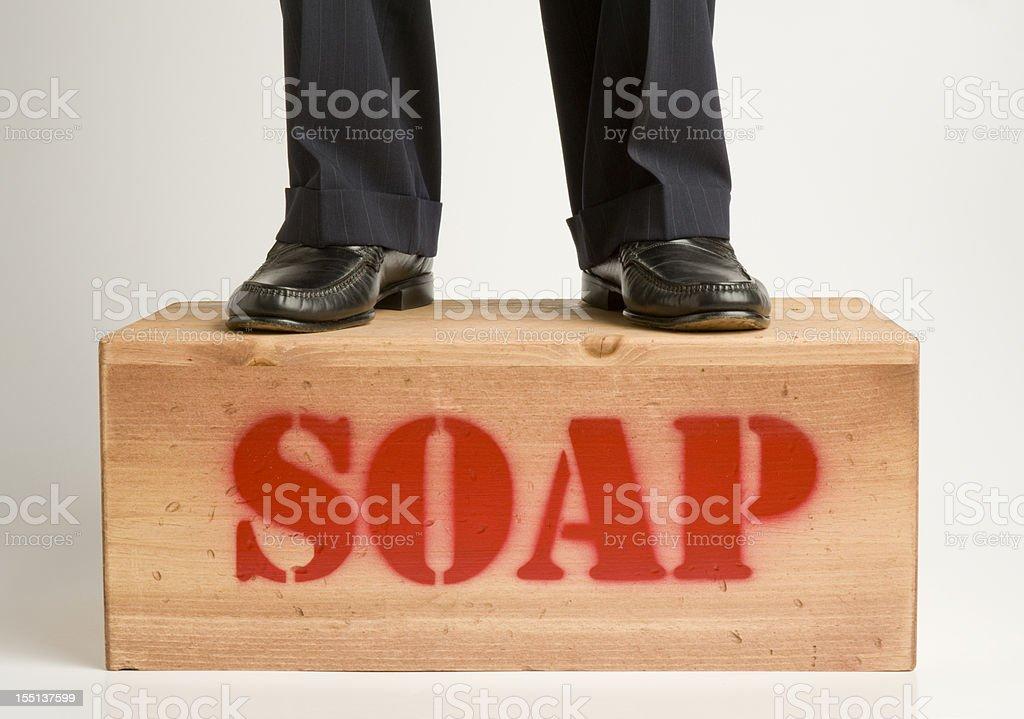 Man in Pinstripe Suit on Soapbox. stock photo