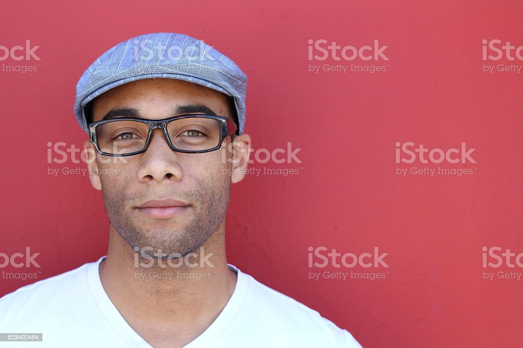 man in plain clothes wearing hat and glasses stock photo