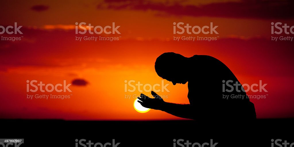 Man in Prayer Panorama Silhouette stock photo