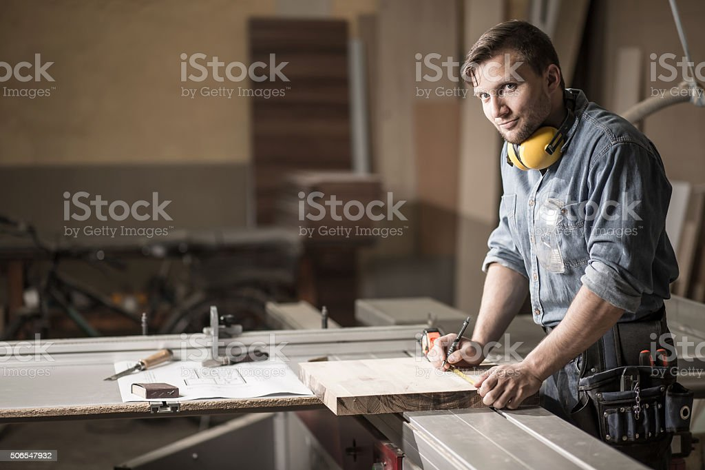 Man in private carpentry workshop stock photo