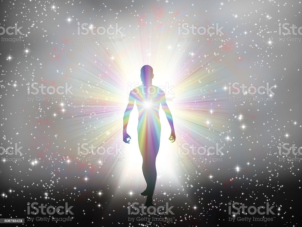 Man in rainbow light and stars stock photo