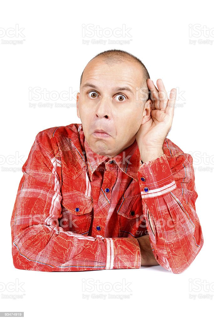 Man in red shirt with hand on his ear stock photo