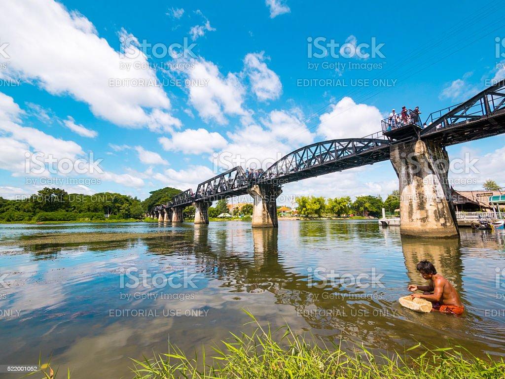 Man in River Kwai Bridge in Kanchanaburi, Thailand stock photo