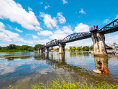 Man in River Kwai Bridge in Kanchanaburi, Thailand