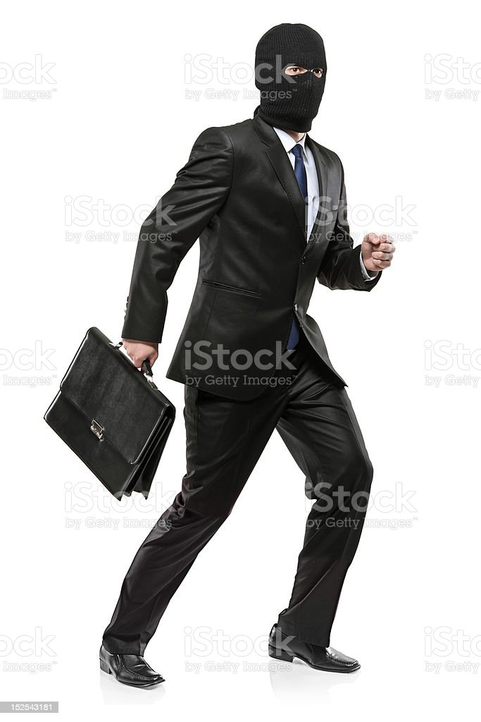Man in robbery mask carrying a briefcase royalty-free stock photo