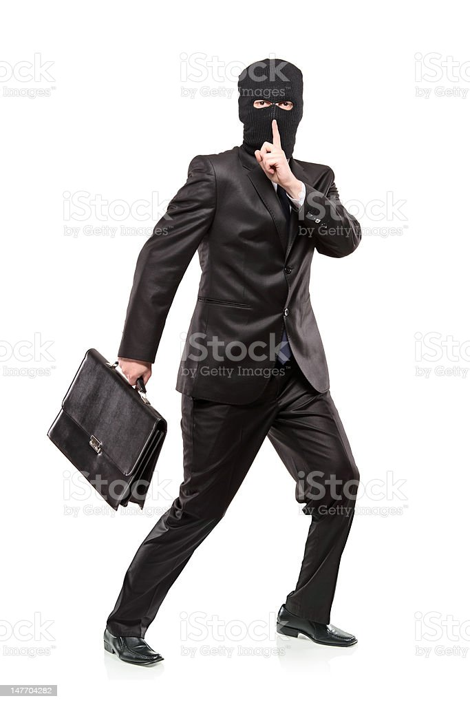 Man in robbery mask stealing a briefcase royalty-free stock photo