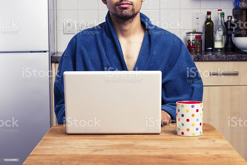 Man in robe working from home royalty-free stock photo