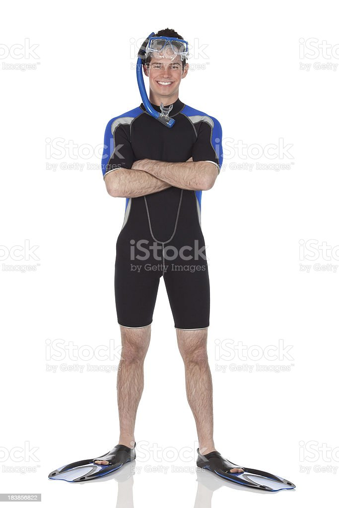 Man in scuba gear standing with arms crossed stock photo