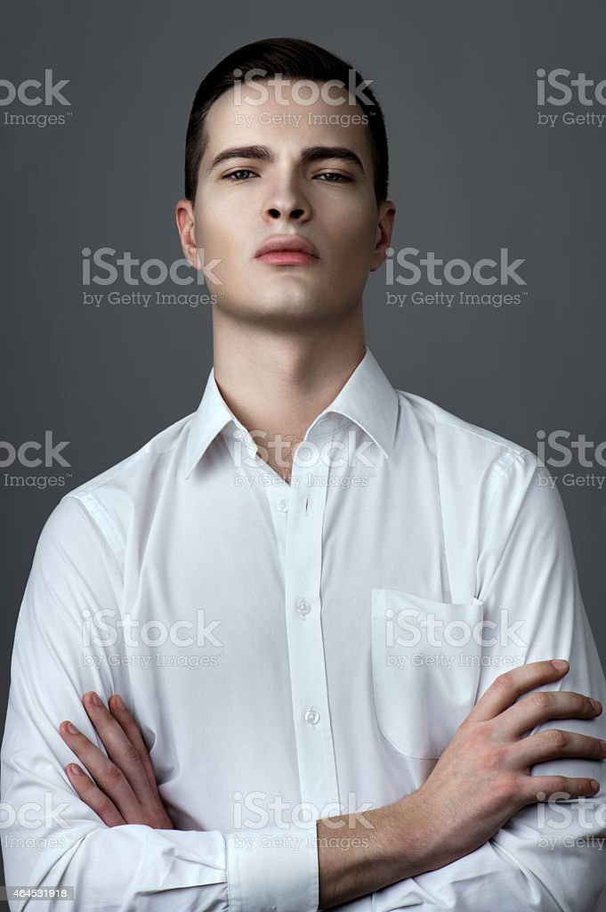 Man in shirt with unbuttoned buttons stock photo