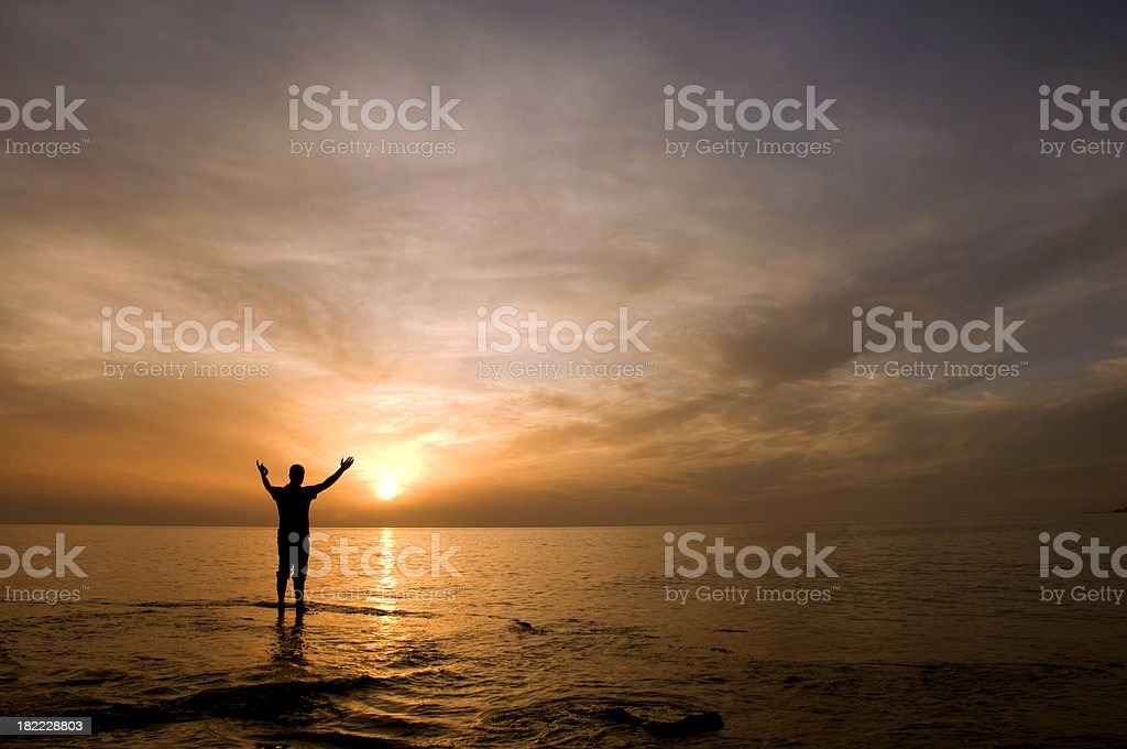 Man in silhouette at sunset royalty-free stock photo