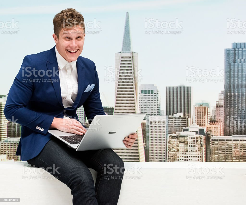 Man in smart casual using laptop stock photo