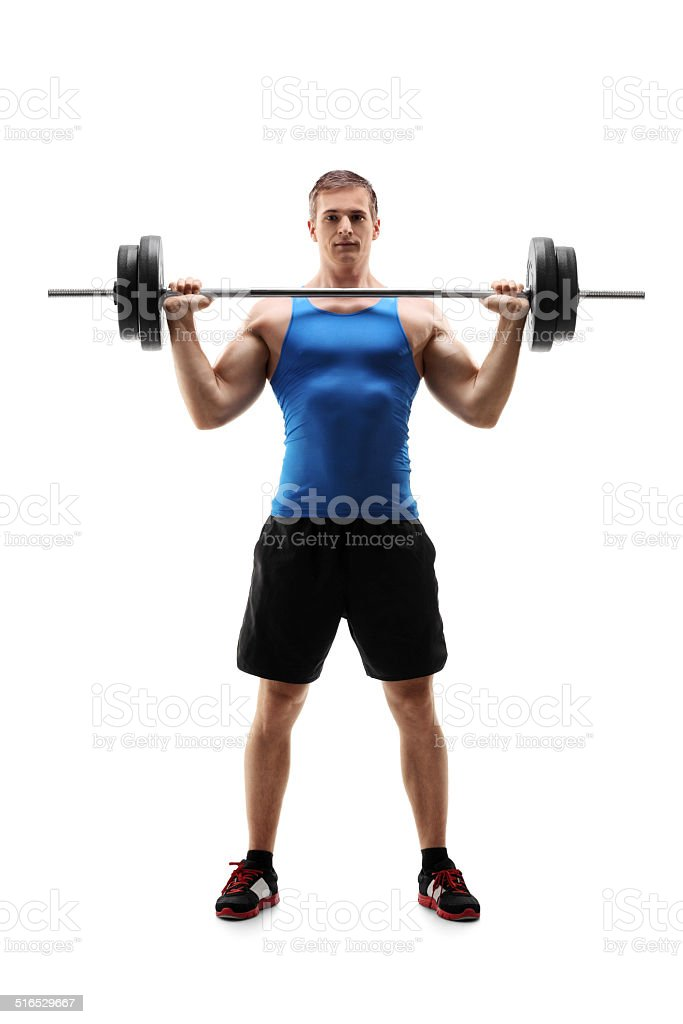 Man in sportswear exercising with a weight stock photo