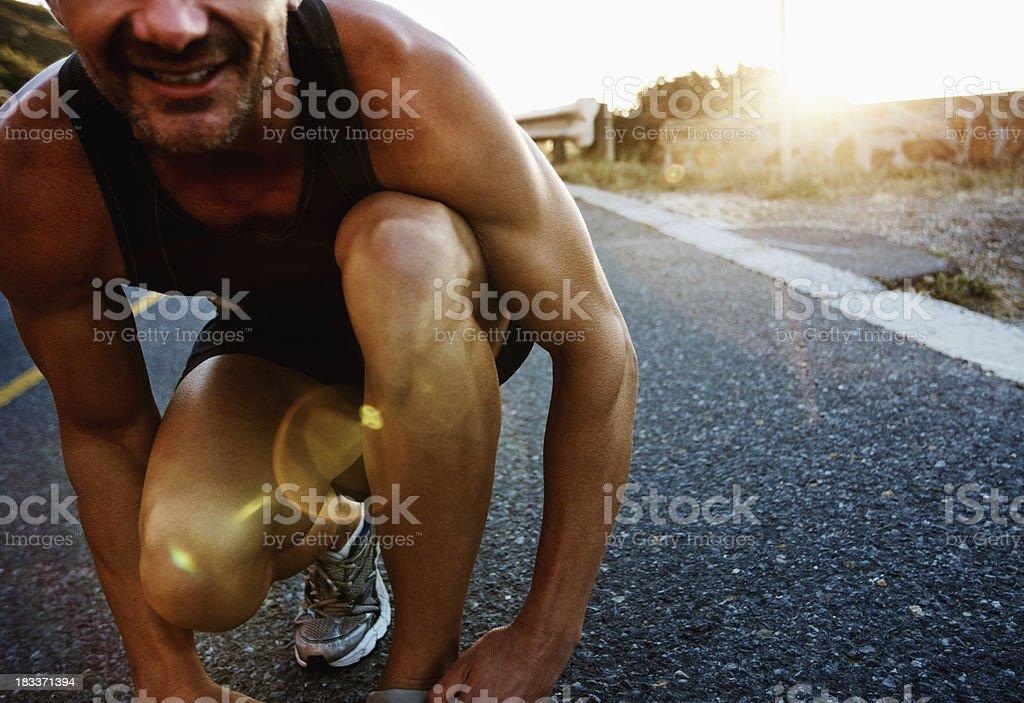 Man in start position stock photo