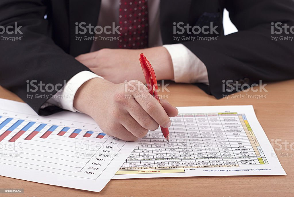 Man in suit and financial papers royalty-free stock photo