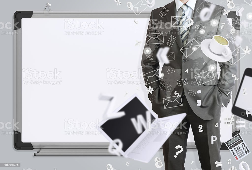 Man in suit and office objects stock photo