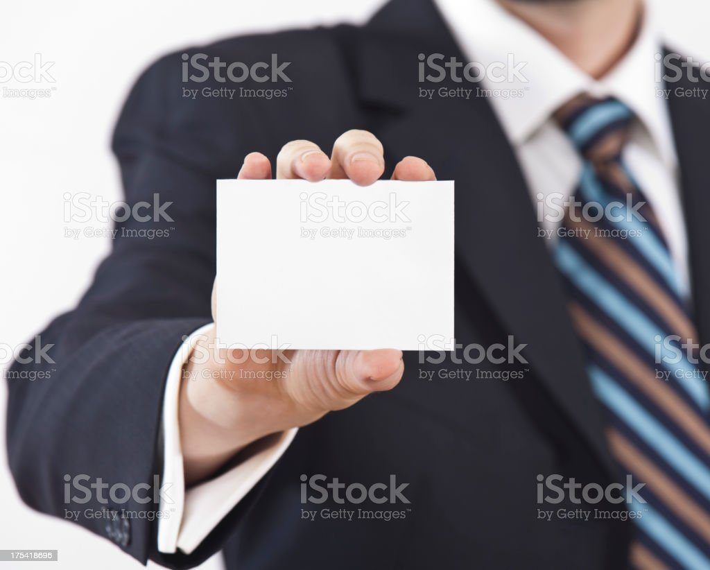 Man in suit arm outstretched holding blank business card royalty-free stock photo