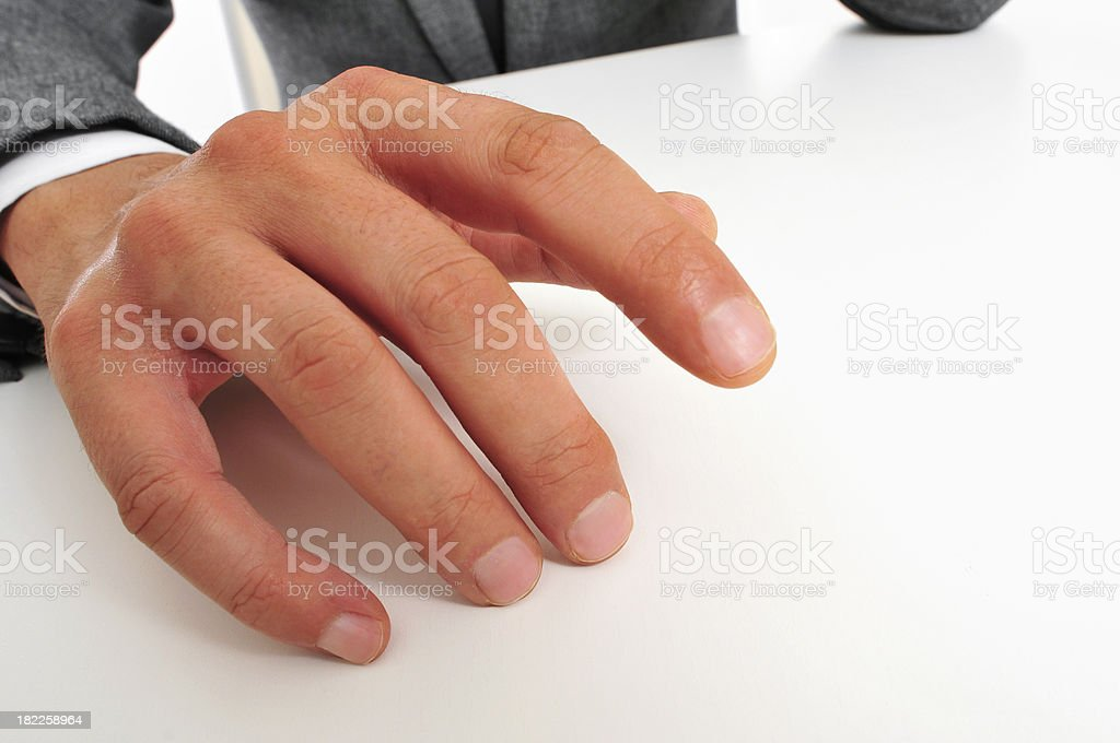 man in suit drumming his fingers stock photo
