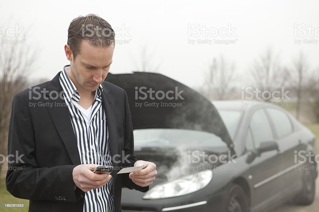Man in suit has just had an car accident royalty-free stock photo