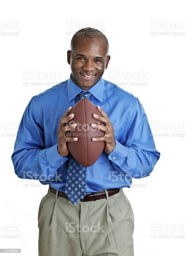 Man in suit holding a football royalty-free stock photo