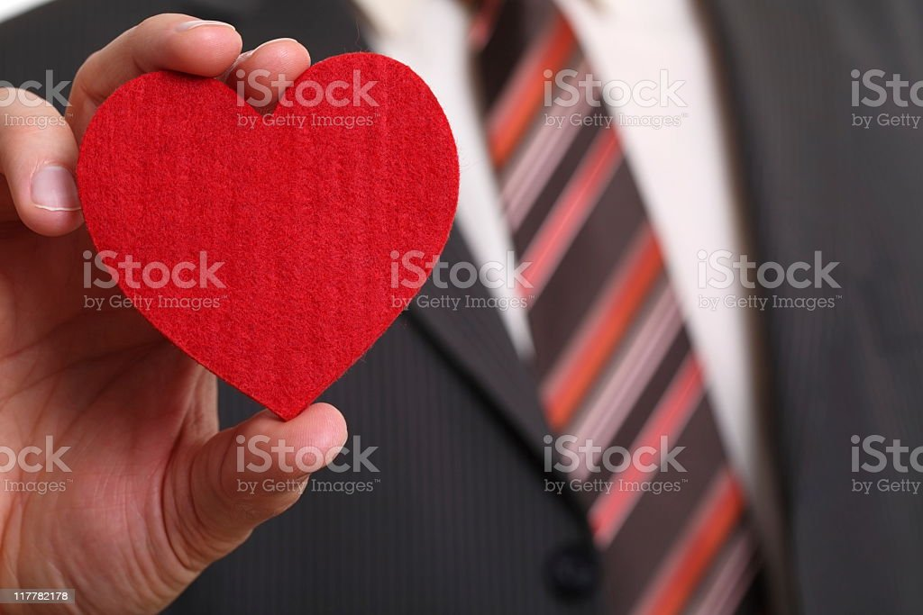 Man in Suit Holding a Heart stock photo