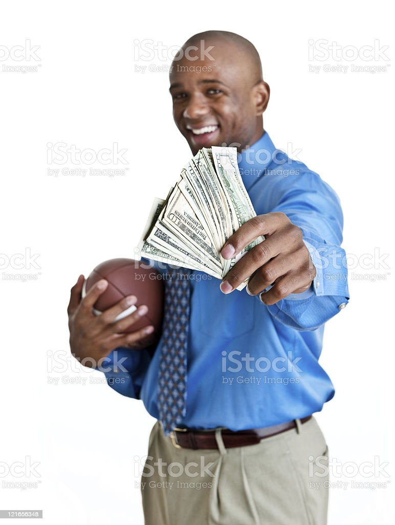 Man in suit holding cash and a football royalty-free stock photo