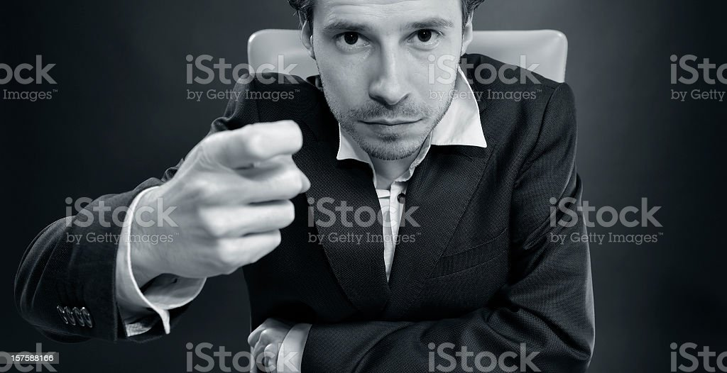 Man in suit is sitting in chair at office, knocking stock photo