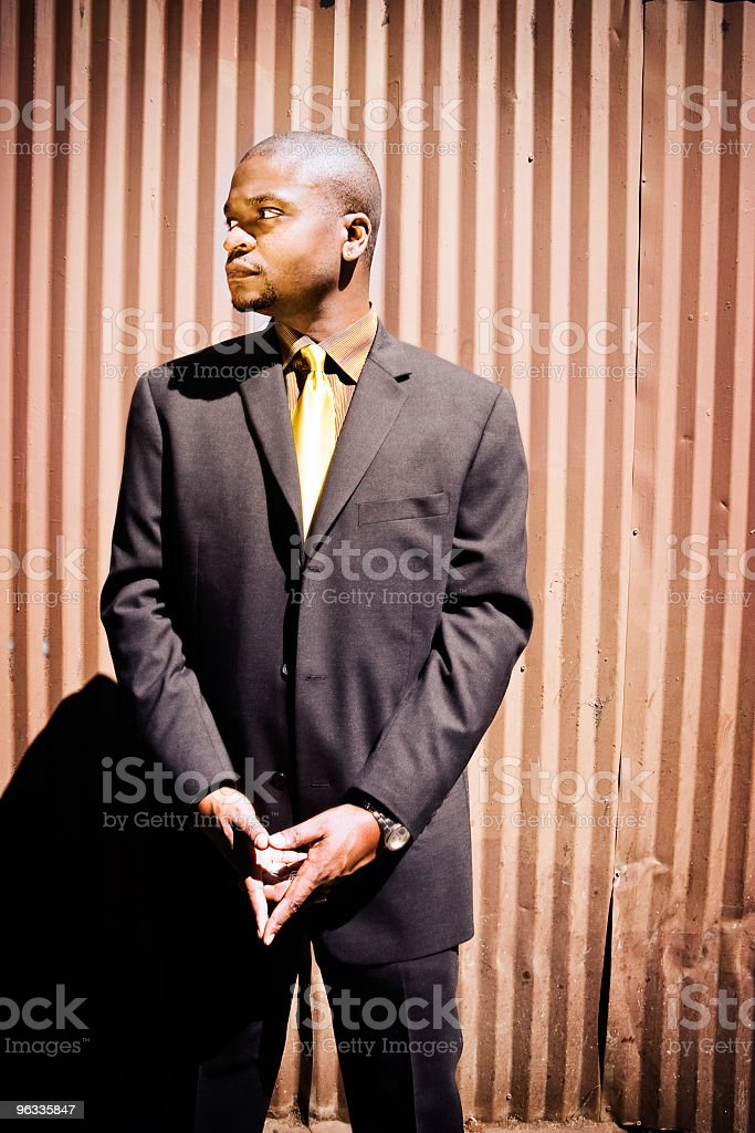 Man in suit looking around royalty-free stock photo