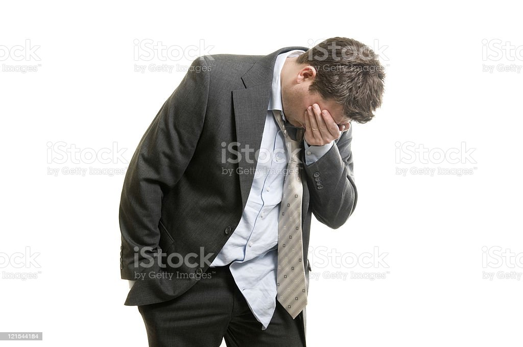 Man in suit looks like he has a hangover stock photo