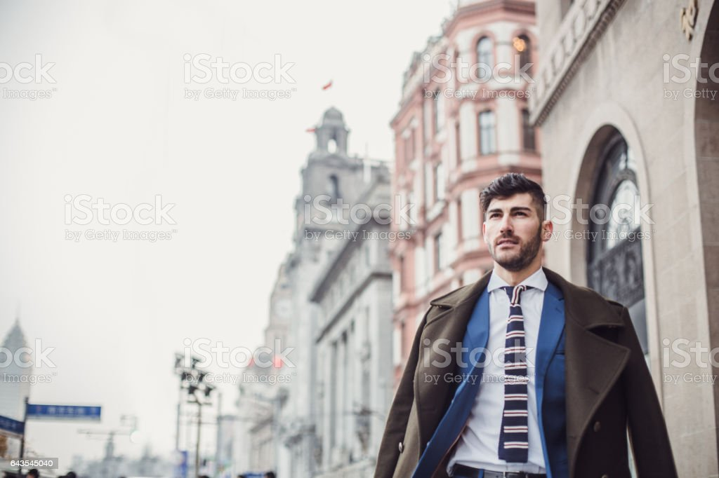 Man in suit on the street stock photo