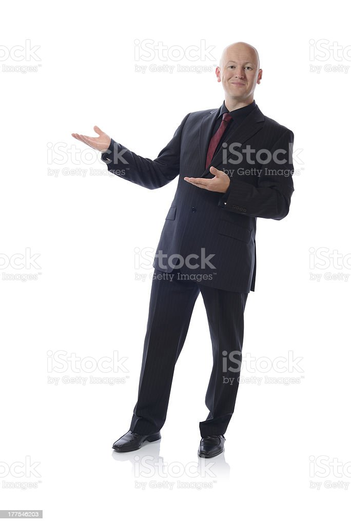 man in suit presenting royalty-free stock photo