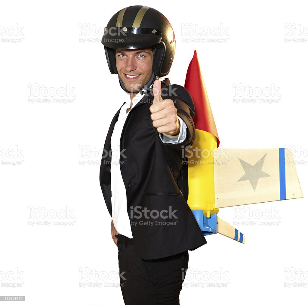 Man in suit ready for take off with helmet and toy rocket royalty-free stock photo