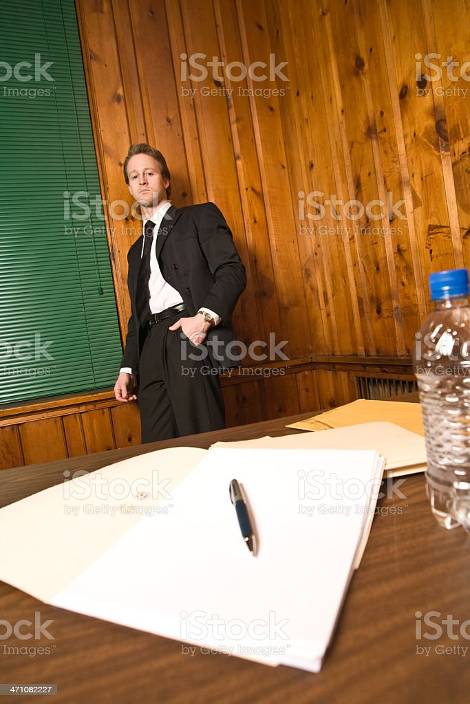 Man in suit - stares at document stock photo