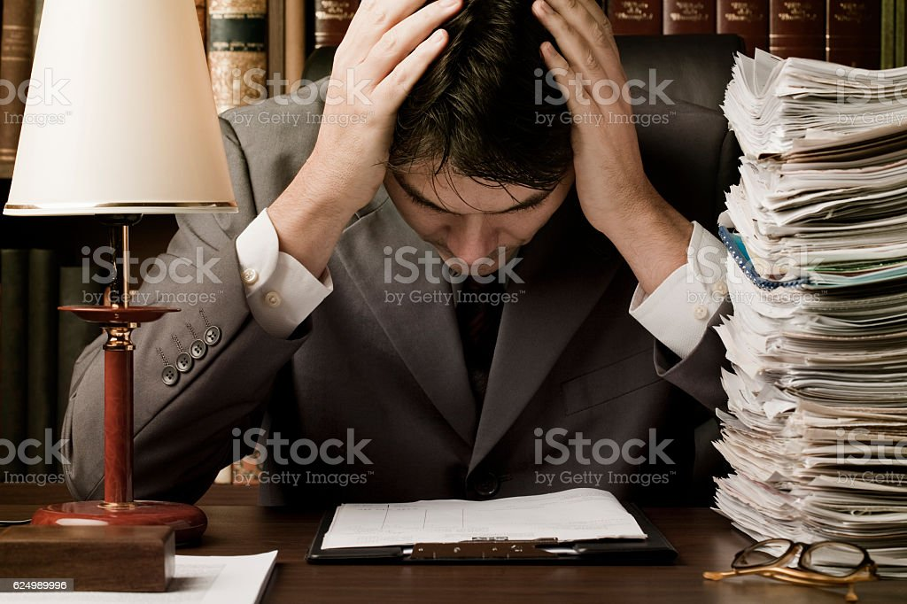 Man in suit stressed by work stock photo