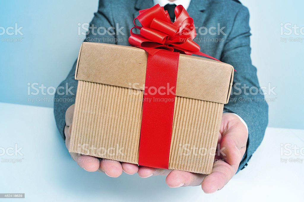 man in suit with a gift royalty-free stock photo