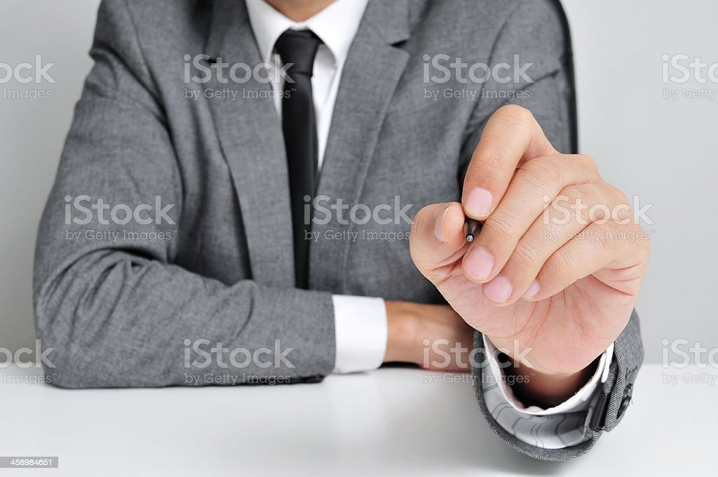 man in suit with a pen royalty-free stock photo