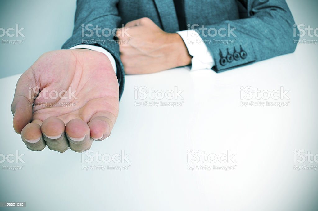 man in suit with an outstretched hand royalty-free stock photo