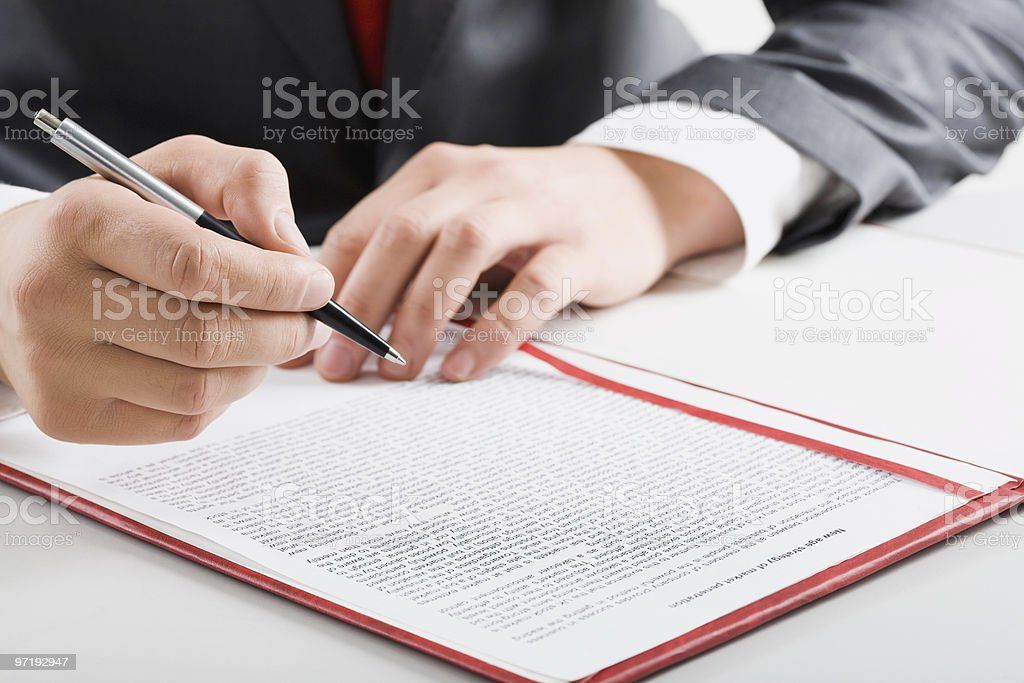 Man in suit with pen and document royalty-free stock photo