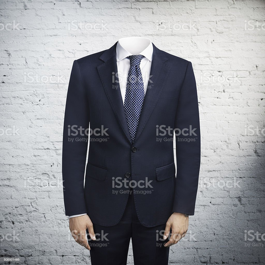man in suit without head stock photo