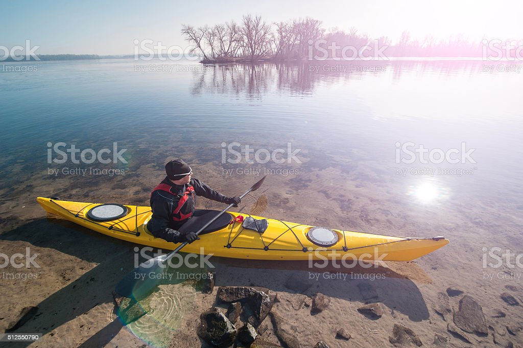 man in sunglasses with the kayak stock photo