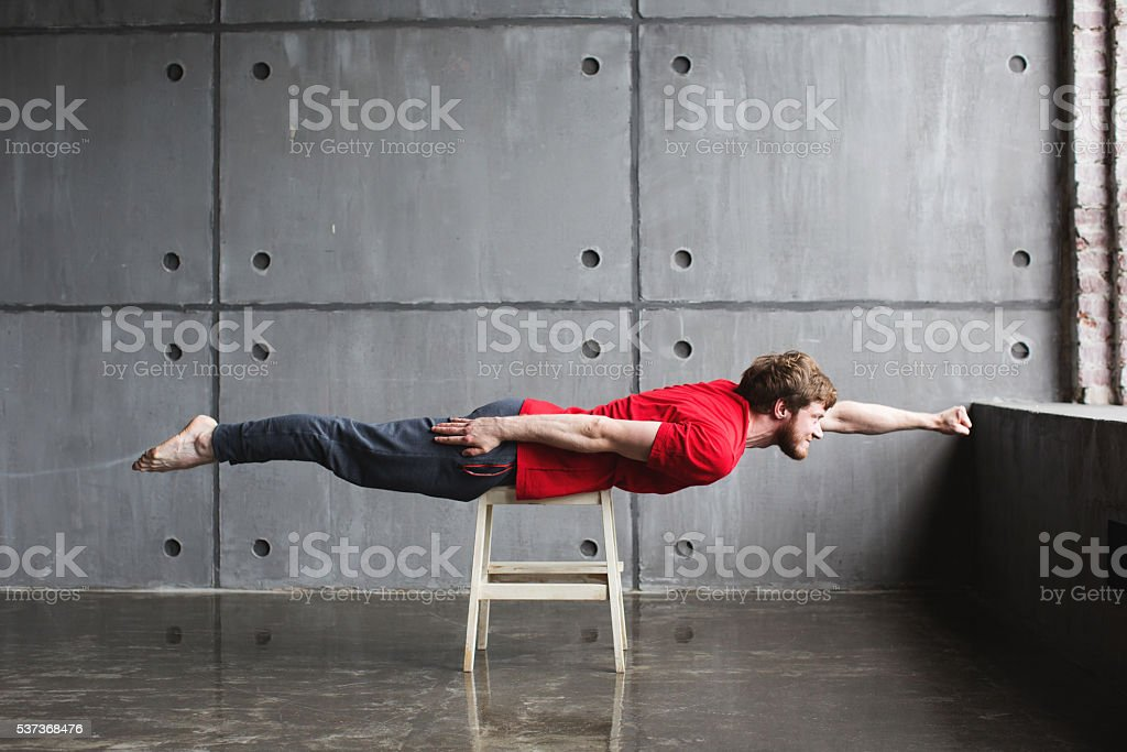 Man in superhero pose stock photo
